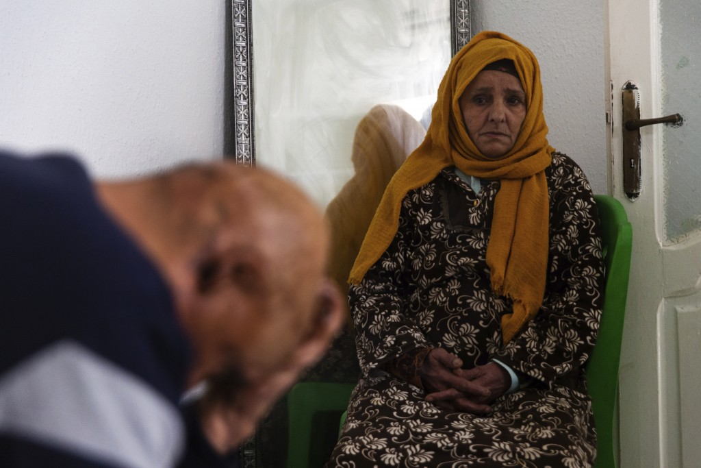Zina Sehi, right, looks at her son, Hosni Kalaia, in Kasserine, Tunisia, on Friday, Dec. 11, 2020. Sehi and Kalaia are among hundreds of Tunisians who...