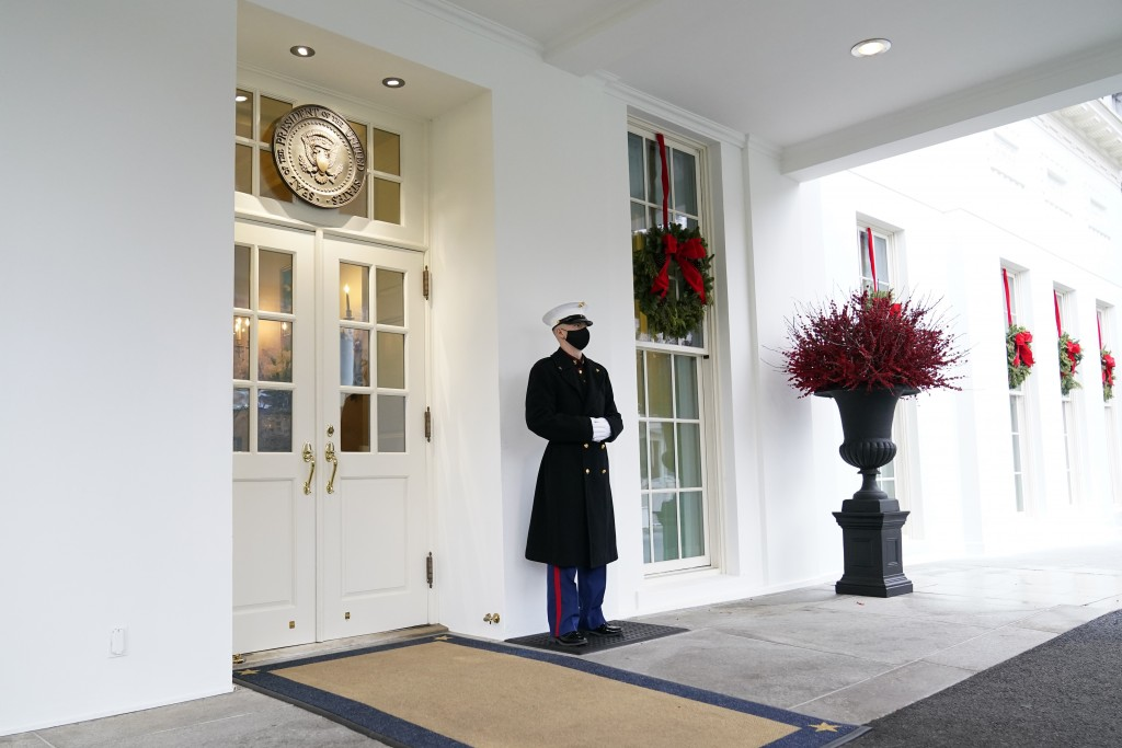 A marine stands outside the West Wing of the White House in Washington, Wednesday, Dec. 16, 2020. (AP Photo/Susan Walsh)