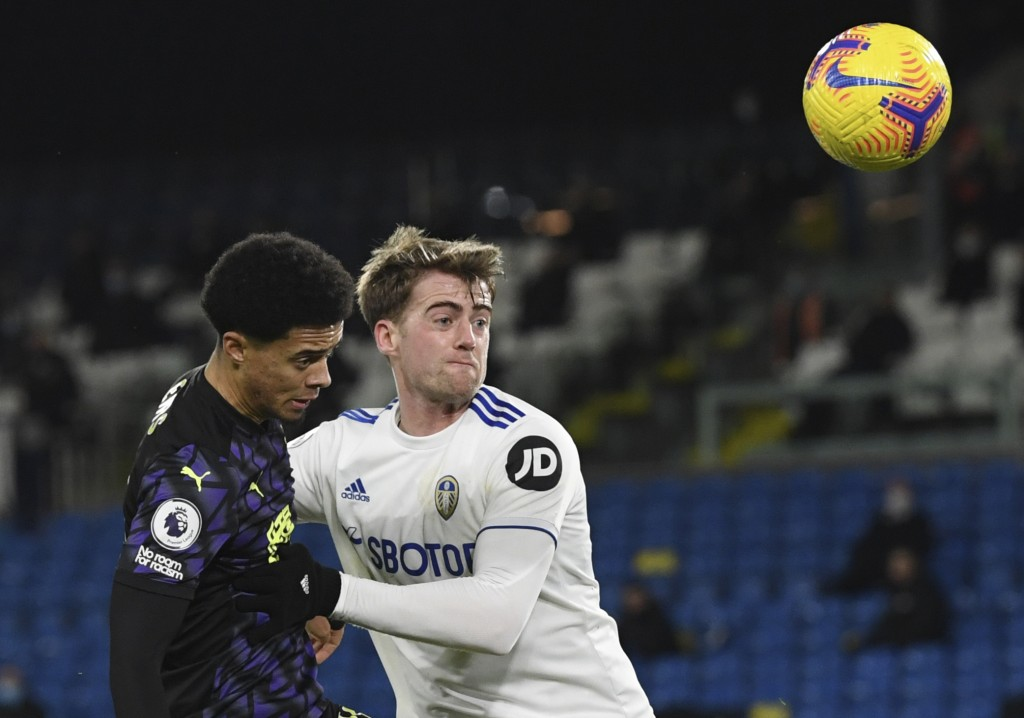 Newcastle's Jamal Lewis, left, duels for the ball with Leeds United's Patrick Bamford during the English Premier League soccer match between Leeds Uni...