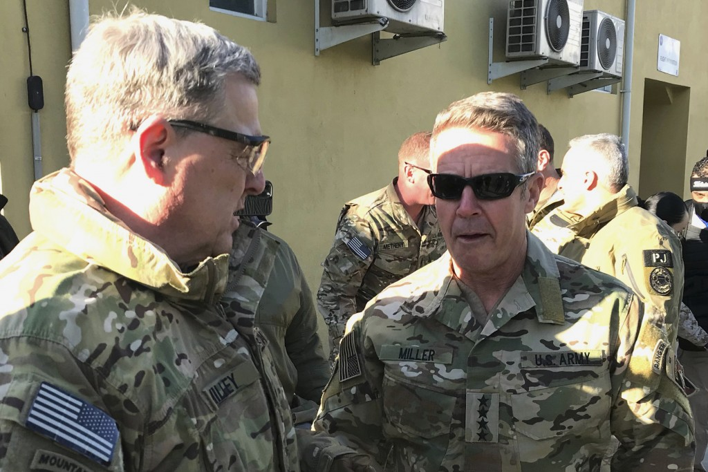 Chairman of the U.S. Joint Chiefs of Staff Gen. Mark Milley, left, talks with Gen. Scott Miller, the commander of U.S. and coalition forces in Afghani...
