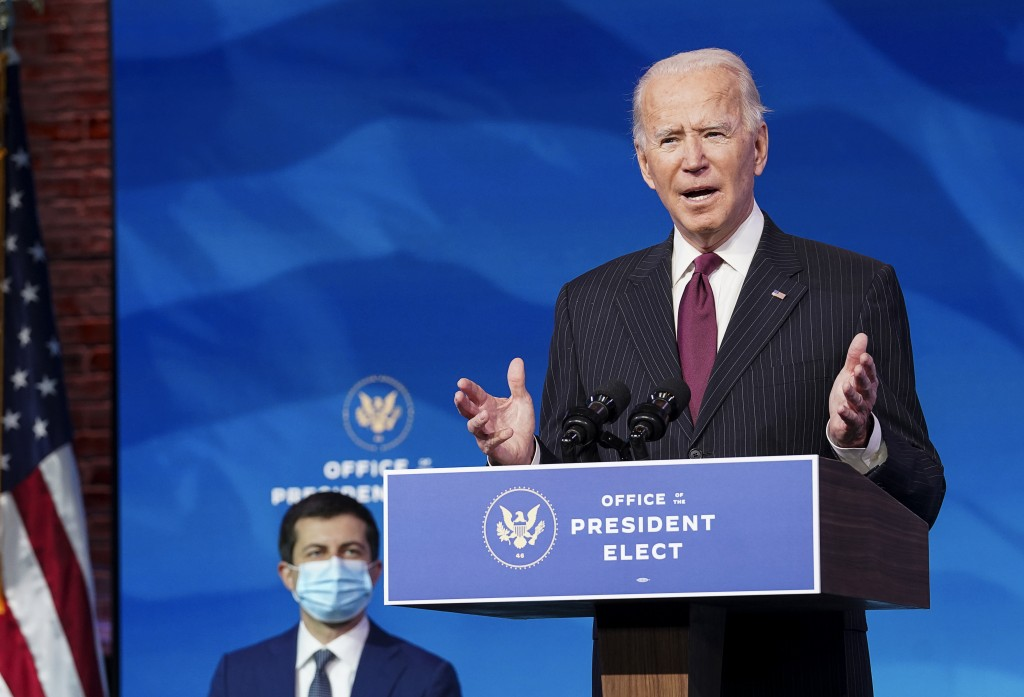 President-elect Joe Biden speaks as he announces former South Bend, Ind. Mayor Pete Buttigieg as his nominee for transportation secretary during a new...
