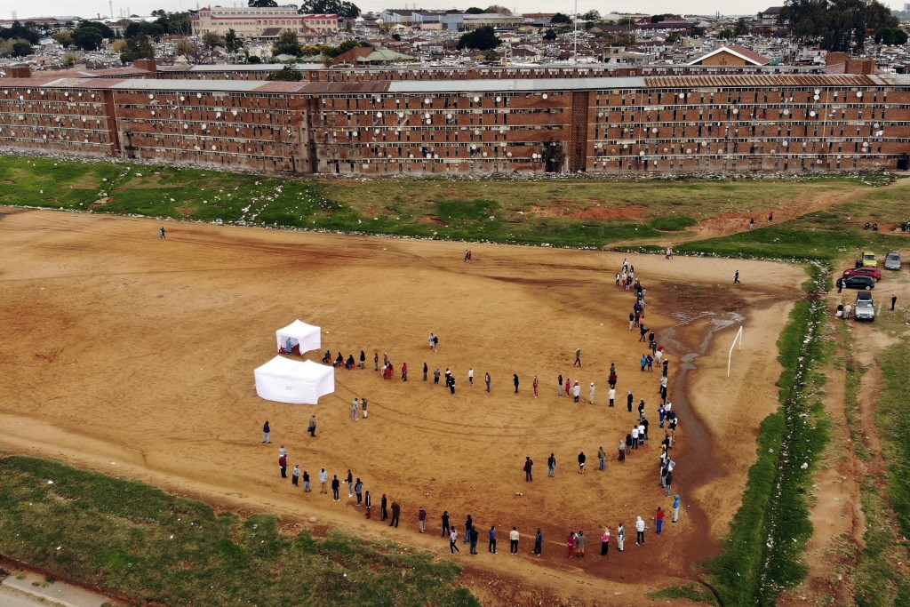 Residents from the Alexandra township in Johannesburg gather in a stadium to be tested for COVID-19 Wednesday, April 29, 2020. It was just a question ...
