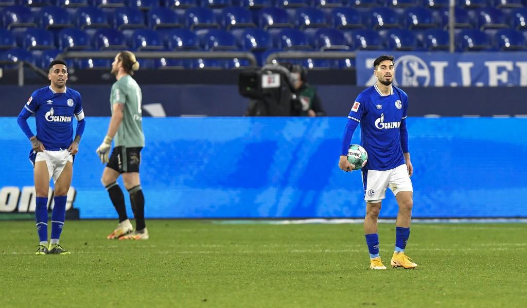 Schalke's Suat Serdar, right, takes the ball after Freiburg scored their second goal during the German Bundesliga soccer match between FC Schalke 04 a...