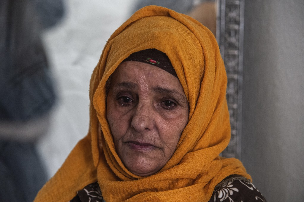 Zina Sehi looks at her son, Hosni Kalaia, in Kasserine, Tunisia, Friday, Dec.11, 2020. Hundreds of desperate Tunisians have set themselves on fire in ...