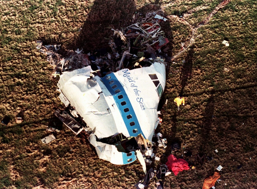 FILE - In this Dec. 22, 1988, file photo police and investigators look at what remains of the nose of Pan Am 103 in a field in Lockerbie, Scotland. Th...