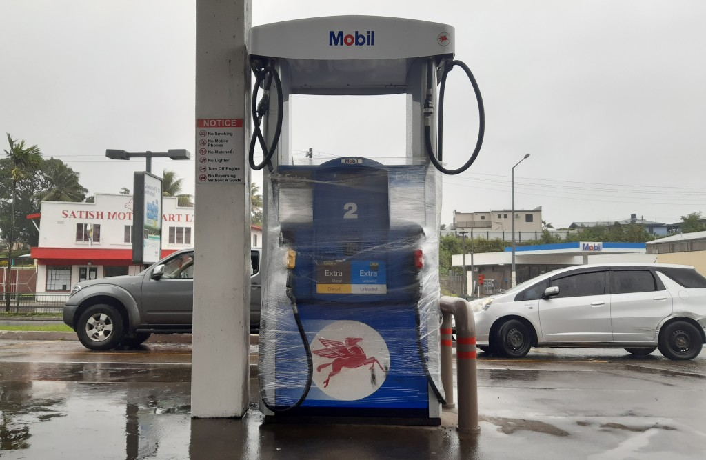 A gas pump is wrapped in the preparation for cyclone Yasa in Suva, Fiji, Thursday, Dec. 17, 2020. Fiji was urging people near the coast to move to hig...