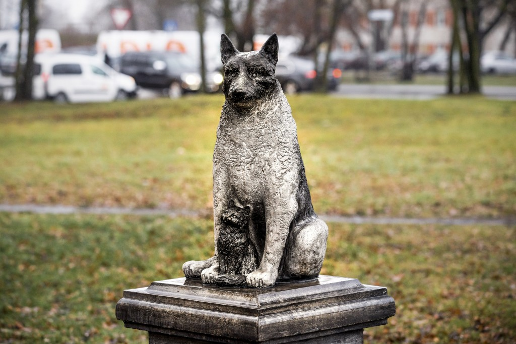 The statue of the stray dog Zorik, warming up a kitten, is placed in front of a shopping center in Tallinn, Estonia, Wednesday, Dec. 16, 2020. The sta...
