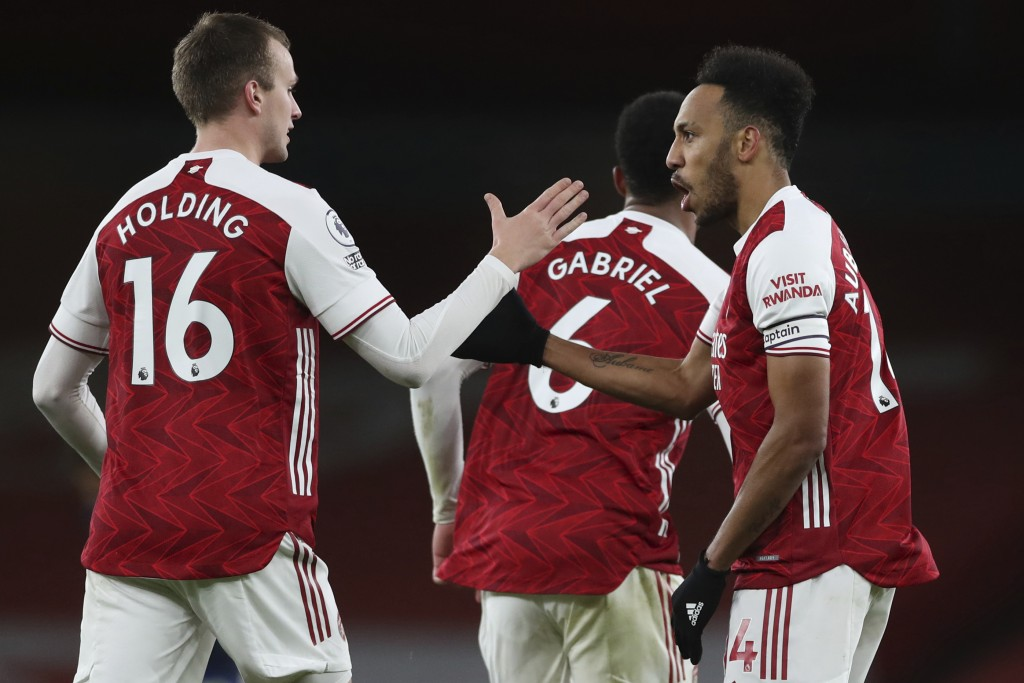 Arsenal's Pierre-Emerick Aubameyang, right, celebrates after scoring his side's first goal during an English Premier League soccer match between Arsen...