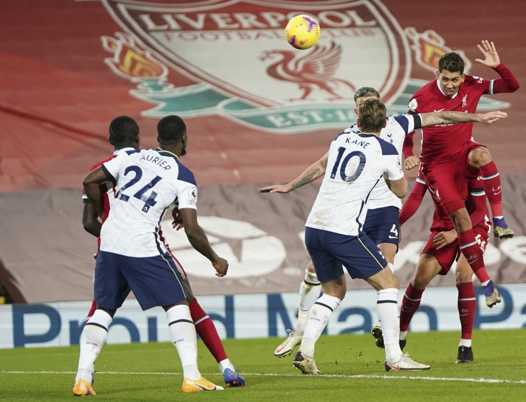Liverpool's Roberto Firmino, right heads the ball and scores his sides 2nd goal of the game during the English Premier League soccer match between Liv...