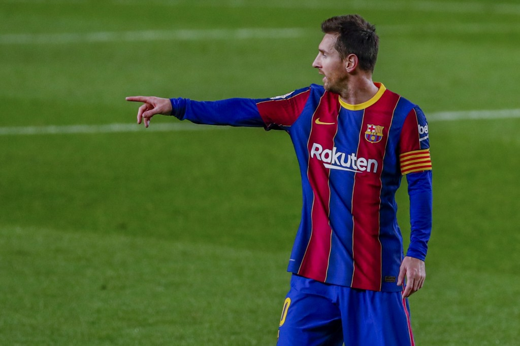 Barcelona's Lionel Messi gestures during the Spanish La Liga soccer match between FC Barcelona and Real Sociedad at the Camp Nou stadium in Barcelona,...