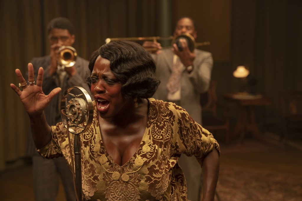 """This image released by Netflix shows Chadwick Boseman, from left, Viola Davis and Colman Domingo in """"Ma Rainey's Black Bottom."""" (David Lee/Netflix via..."""
