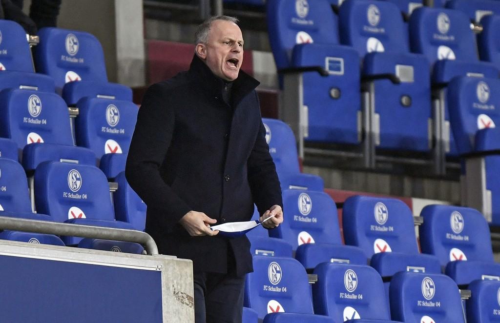 Schalke manager Jochen Schneider reacts on the tribune during the German Bundesliga soccer match between FC Schalke 04 and SC Freiburg at the Arena in...