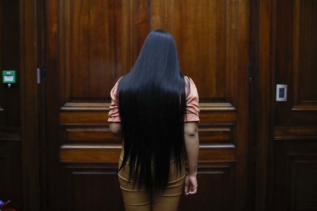 Transgender woman Angeles Rojas enters a room at Banco Nación where she works in Buenos Aires, Argentina, Thursday, Nov. 5, 2020. Rojas, 23, joined th...