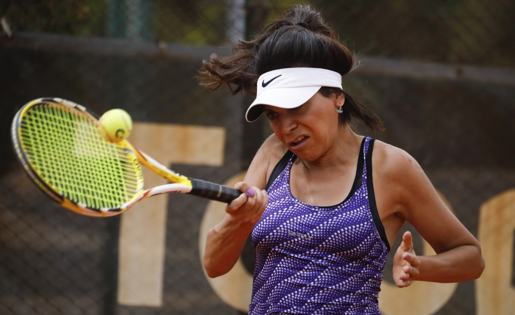 Transgender tennis player Mia Fedra returns the ball during a training session in Buenos Aires, Argentina, Friday, Dec. 4, 2020. There are no official...