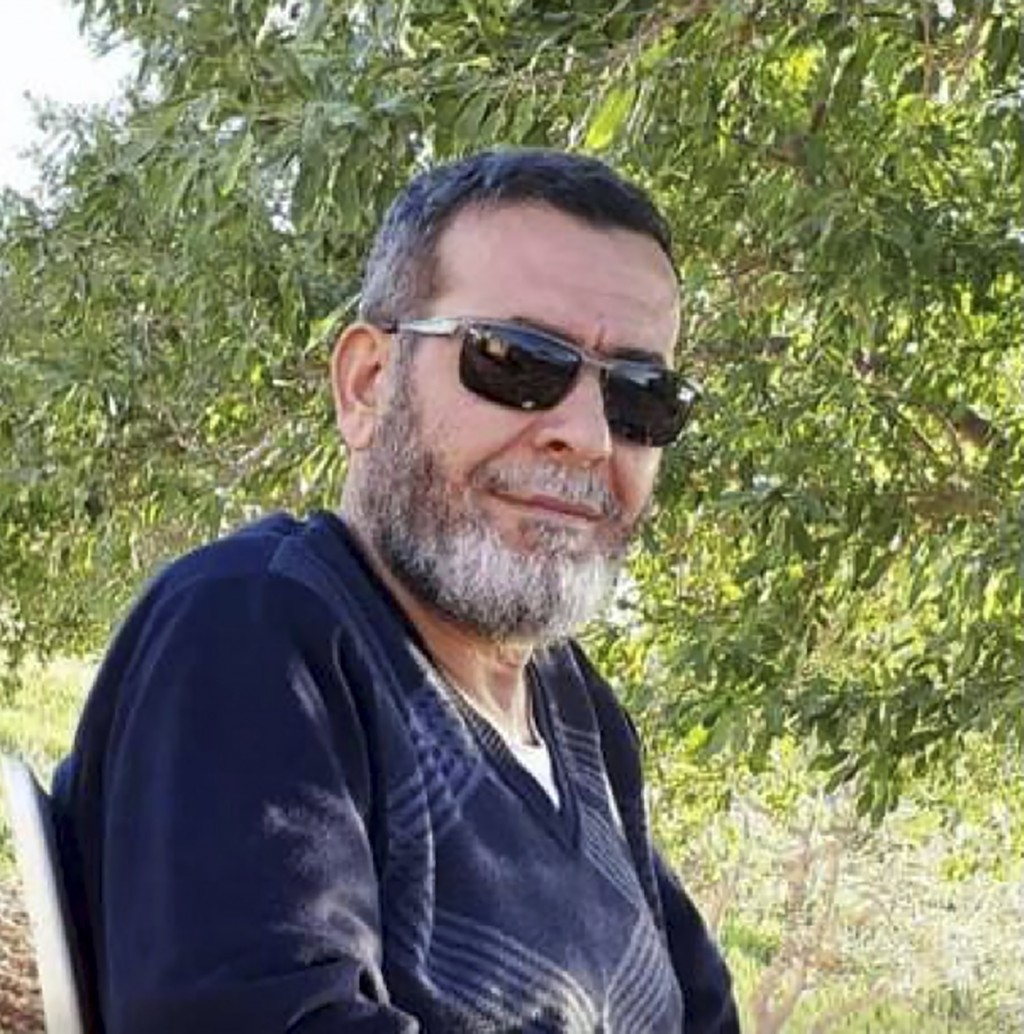 This undated photo provided by his son Kenan Aljasem shows Dr. Adnan Jasem in Albad, Syria. Jasem had every reason to leave war-torn Syria after survi...
