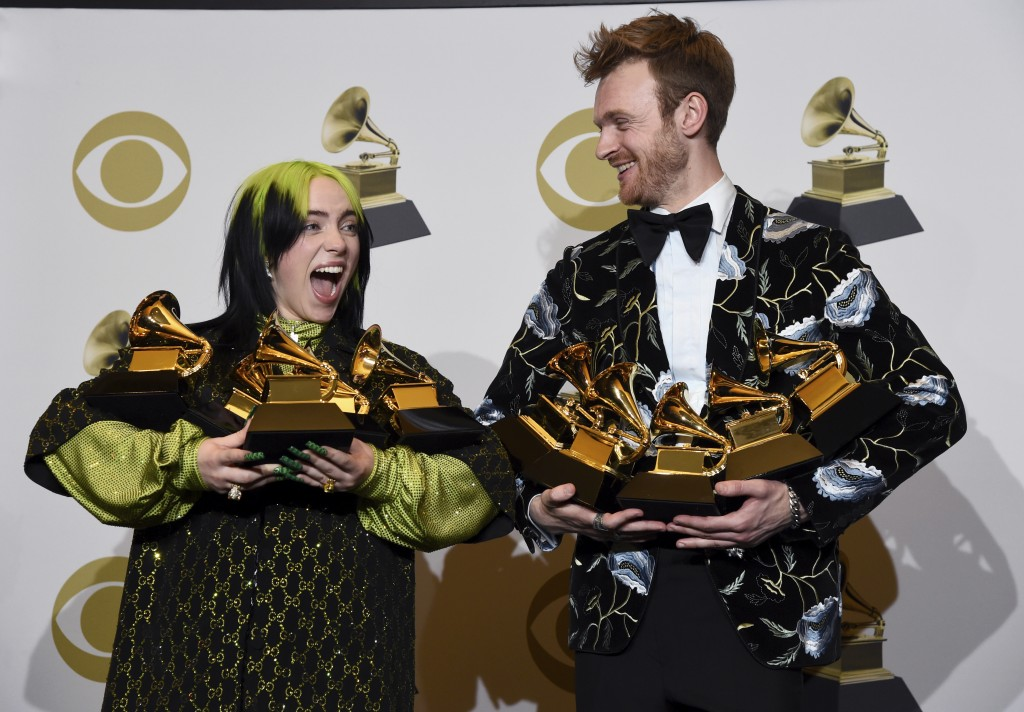 FILE - Billie Eilish, left, and Finneas O'Connell pose in the press room with the awards for best album, best engineered album and best pop vocal albu...