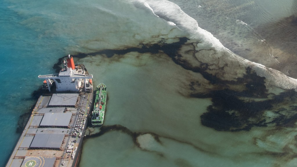 This Tuesday, Aug. 11, 2020 photo provided by the French Army shows oil leaking from the MV Wakashio, a bulk carrier ship that ran aground on a coral ...