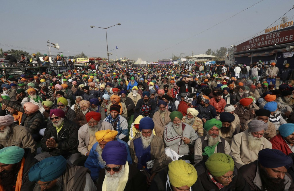 Protesting farmers listen to a speaker at the Delhi- Haryana border, outskirts of New Delhi, India, Thursday, Dec. 17, 2020. India's Supreme Court on ...