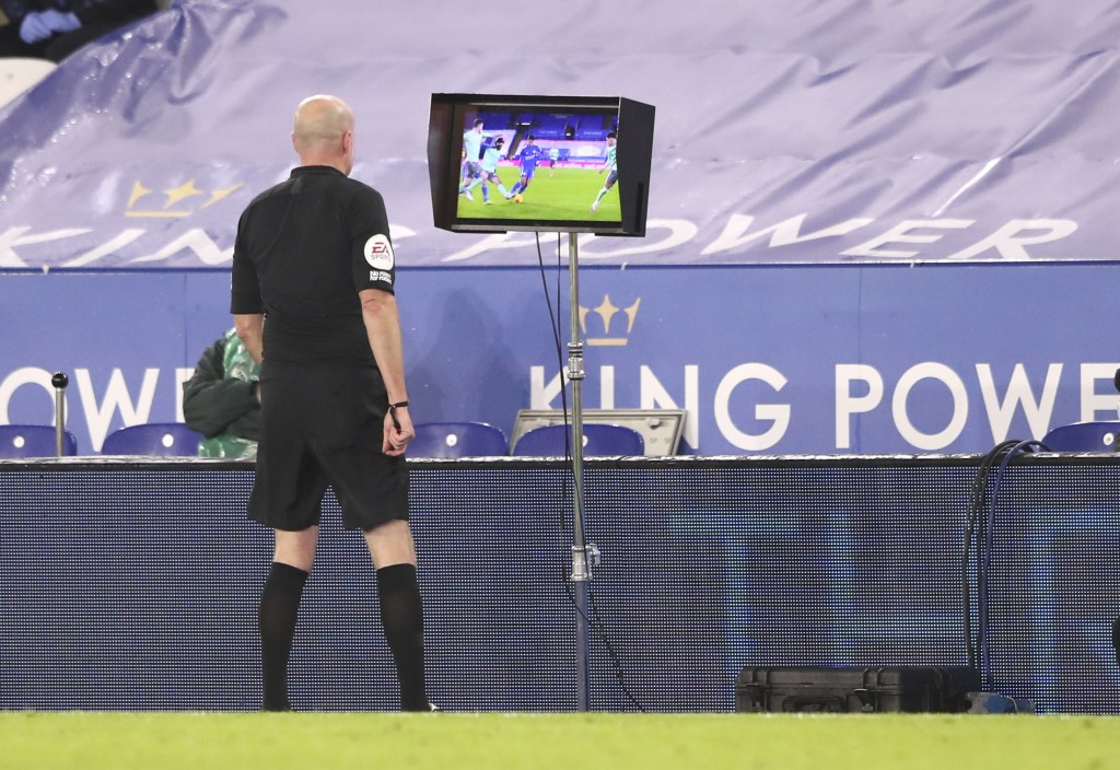 Referee Lee Mason watching the VAR monitor during the English Premier League soccer match between Leicester City and Everton at the King Power Stadium...