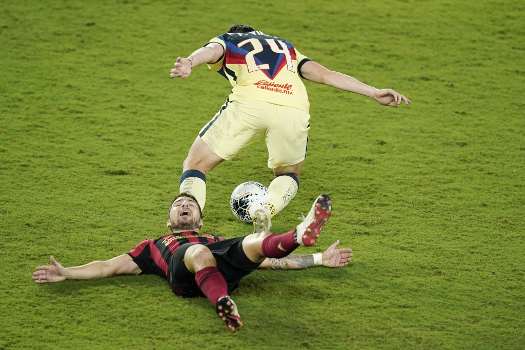 Club America forward Federico Vinas (24) gets possession of the ball after colliding with Atlanta United midfielder Eric Remedi, lower left, during th...
