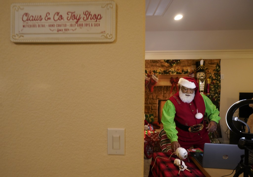 Larry Jefferson prepares to portray Santa Claus for virtual visits with kids from his home in Duncanville, Texas, on Dec. 9, 2020. In this socially di...