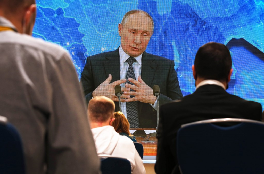 Russian President Vladimir Putin gestures as he speaks via video call during a news conference in Moscow, Russia, Thursday, Dec. 17, 2020. This year, ...