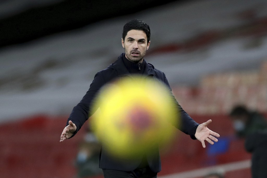 Arsenal's manager Mikel Arteta gestures as the ball passes in front of him during an English Premier League soccer match between Arsenal and Southampt...