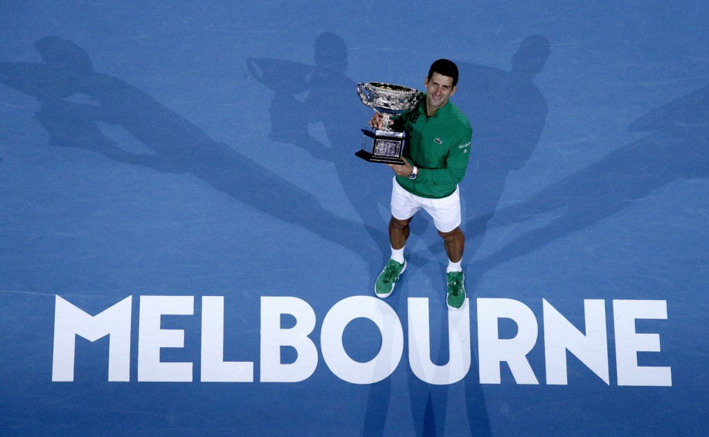 FILE - In this Monday, Feb. 3, 2020 file photo, Serbia's Novak Djokovic holds the Norman Brookes Challenge Cup after defeating Austria's Dominic Thiem...