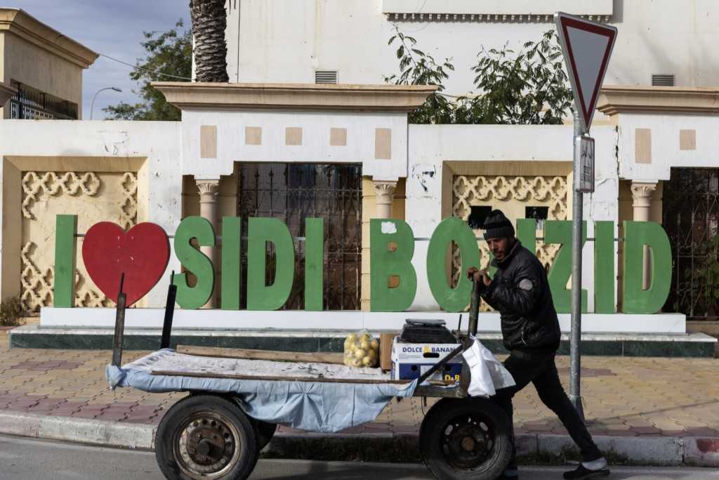 A man pushed his trolley in Sidi Bouzid, Tunisia, Friday Dec. 11, 2020. Hundreds of desperate Tunisians have set themselves on fire over the past 10 y...