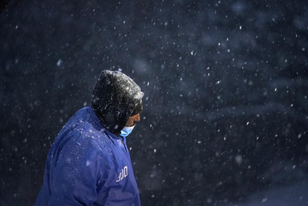 A man walks through the Villanova University campus during a snow storm, Wednesday, Dec. 16, 2020, in Villanova, Pa. (AP Photo/Matt Slocum)