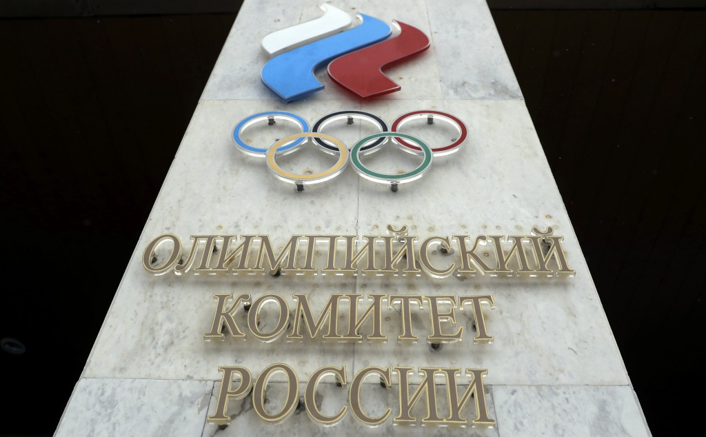 FILE - In this file photo dated Wednesday, Dec. 6, 2017, the logo of the Russian Olympic Committee at the entrance of the head office in Moscow, Russi...