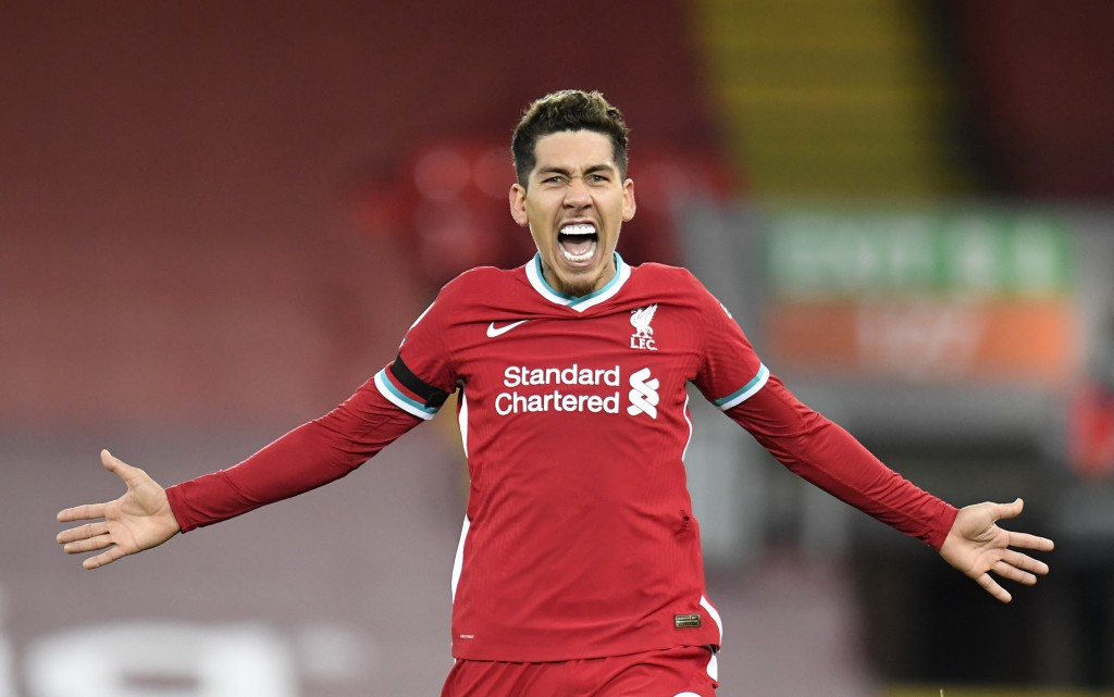 Liverpool's Roberto Firmino celebrates after scoruing his side's 2nd goal during their English Premier League soccer match between Liverpool and Totte...