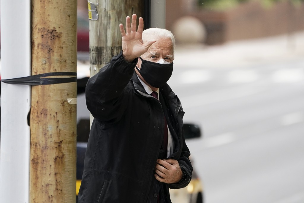 President-elect Joe Biden waves as he arrives at The Queen theater in Wilmington, Del., Wednesday, Dec. 16, 2020. (Kevin Lamarque/Pool via AP)