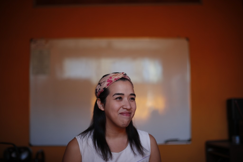 Transgender woman Fabiana Rodriguez smiles during an interview where she works as a teacher at the English Institute in Buenos Aires, Argentina, Frida...