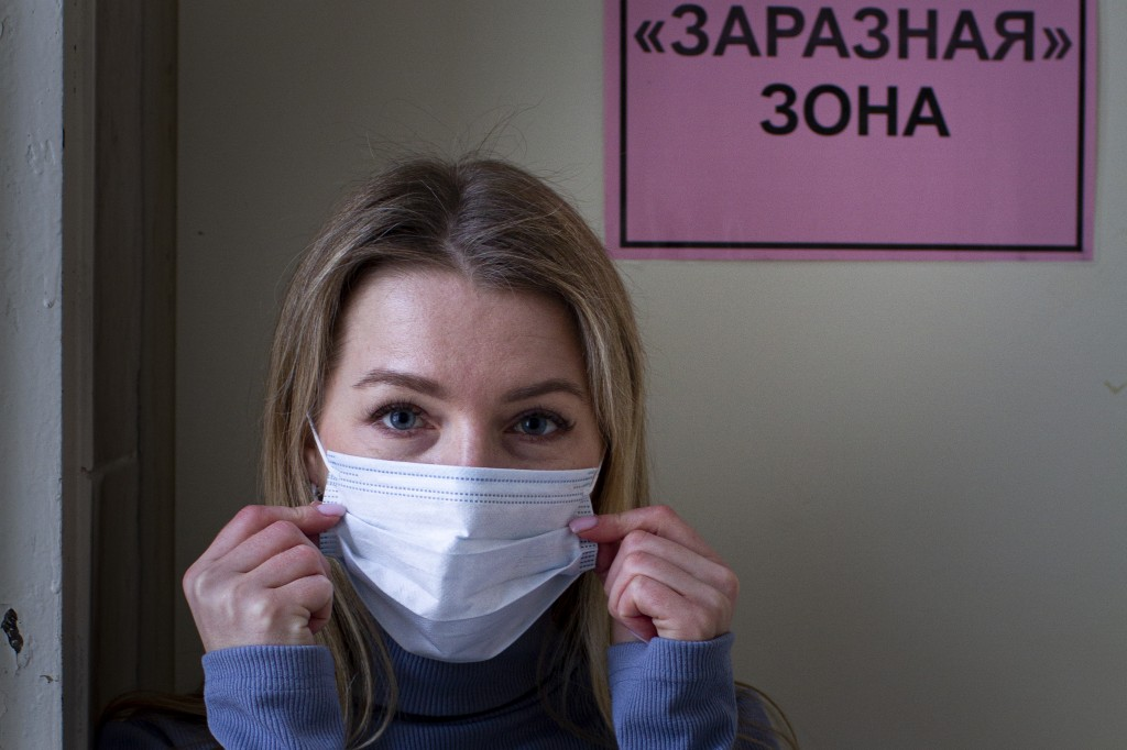 """Dr. Yevgenia Alexeyeva, an infectious disease specialist stands in front of the door of """"Contagious Area"""" at a hospital in the Siberian city of Tomsk ..."""
