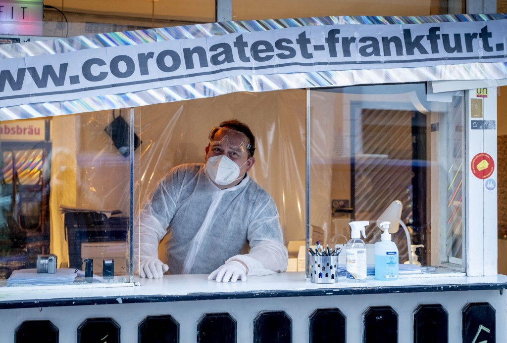 Doctor Georg Siemon looks out of a traditional small Frankfurt kiosk (Trinkhalle) in Frankfurt, Germany, Thursday, Dec.17, 2020. The doctor offers COV...