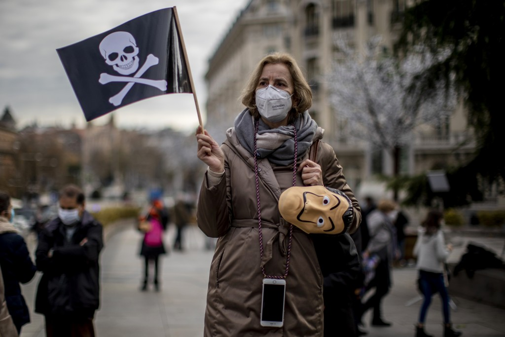 People protest against a law to legalize euthanasia in front of the Spanish Parliament in Madrid, Spain, Thursday, Dec. 17, 2020. The Spanish Parliame...