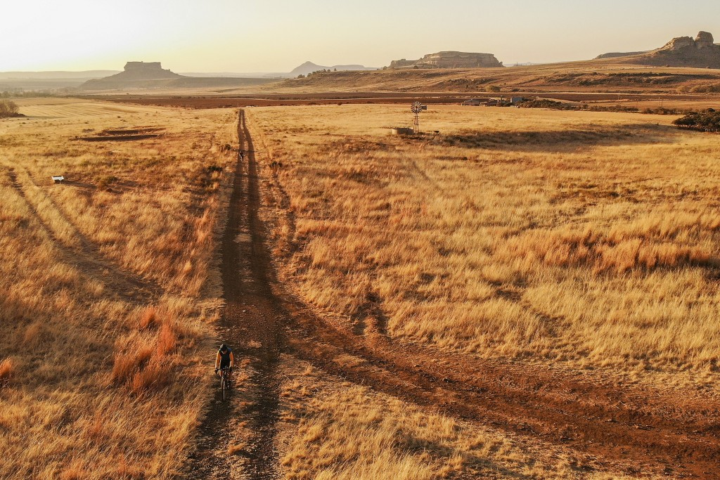 Cyclists ride the gavel roads of the Free States outside Clarens, South Africa, Saturday Aug. 8, 2020. The Covid-19 pandemic has come into full force ...