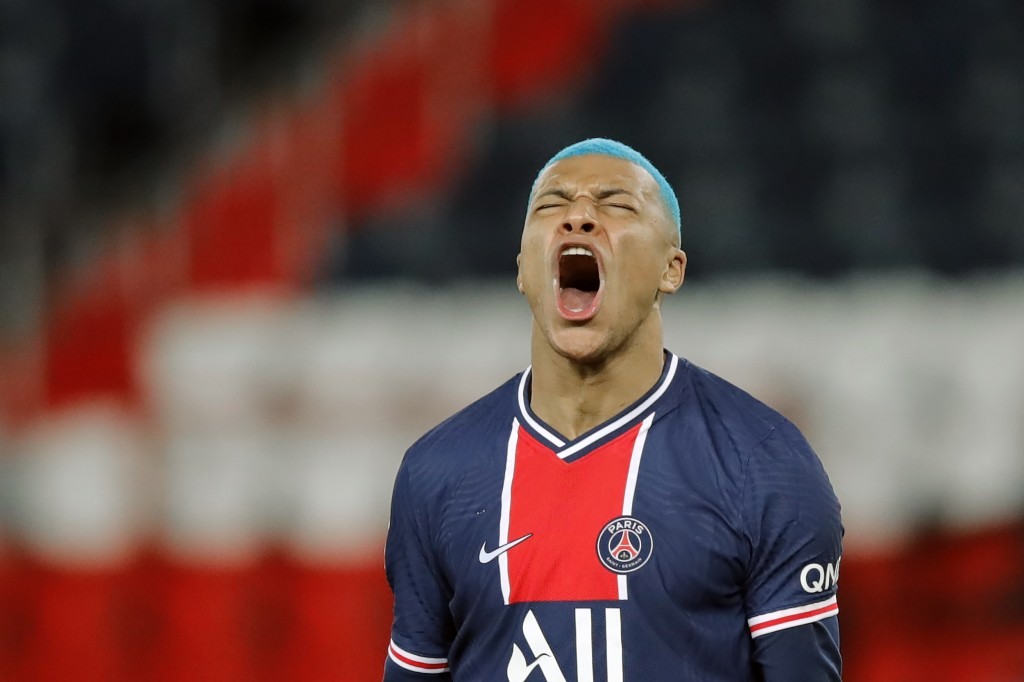 PSG's Kylian Mbappe reacts after missing a goal during the French League One soccer match between Paris Saint-Germain and Lorient at the Parc des Prin...