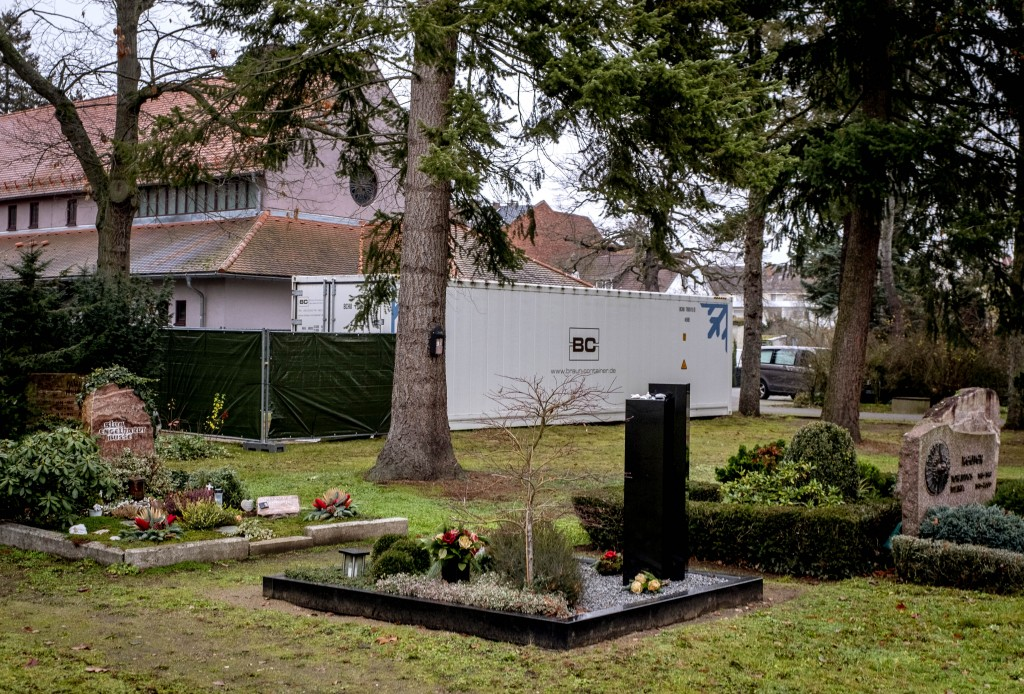 A refrigeration container storing Covid-19 victims stands on the cemetery in Hanau near Frankfurt, Germany, Thursday, Dec. 17, 2020. The stored bodies...