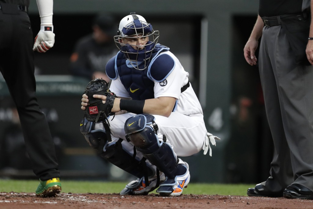 FILE - In this  Friday, Aug. 23, 2019 file photo, Tampa Bay Rays catcher Mike Zunino looks toward the dugout during the first inning of a baseball gam...