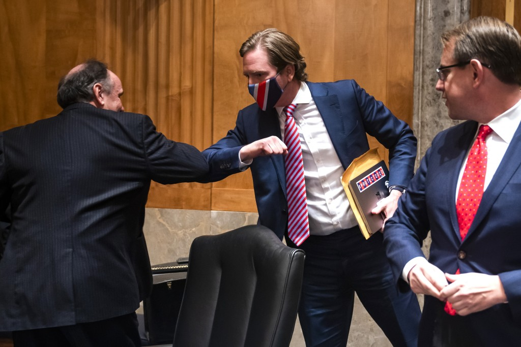 Trump campaign attorney James Troupis elbow bumps Christopher Krebs, former director of the Cybersecurity and Infrastructure Security Agency, after a ...