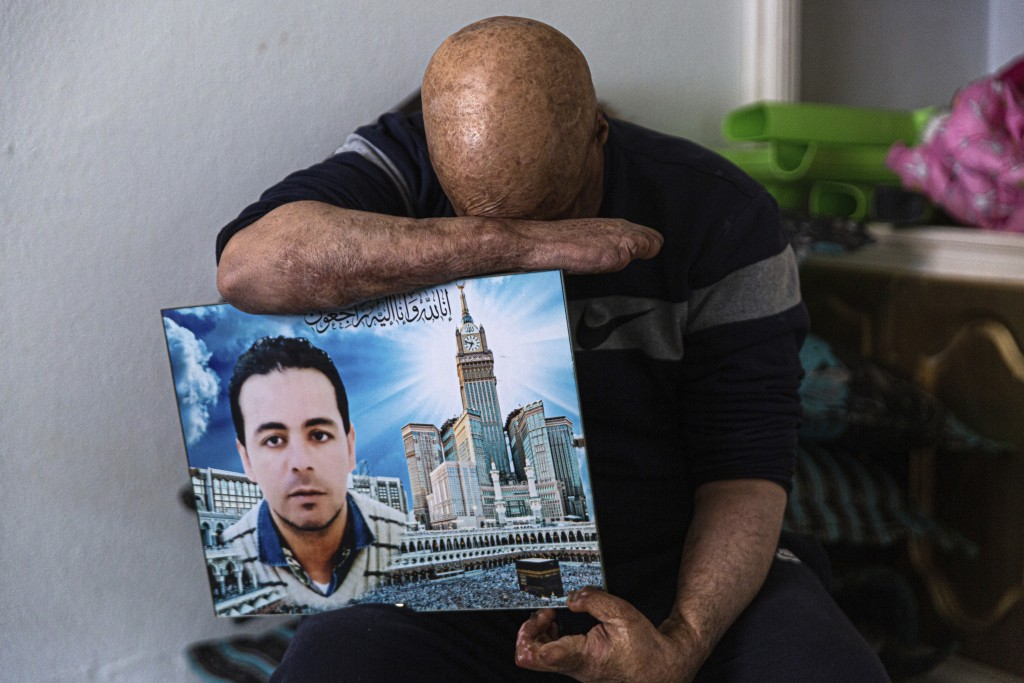 Hosni Kalaia, 49, displays a photo on Friday, Dec. 11, 2020, that shows his younger brother, Sabre, who died after setting himself ablaze in 2015, in ...