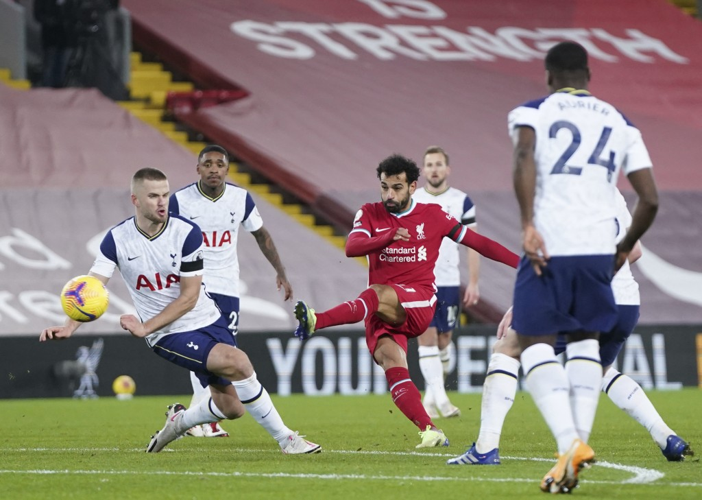 Liverpool's Mohamed Salah, center, attempts a shot on goal during the English Premier League soccer match between Liverpool and Tottenham Hotspur at A...