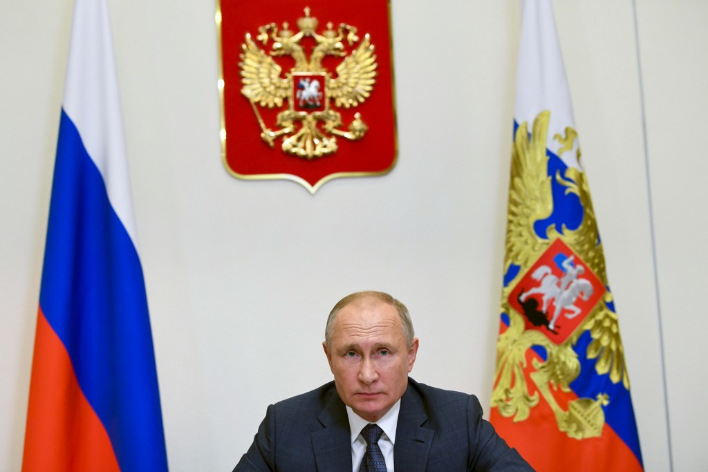 FILE - In this file photo taken Wednesday, Dec. 2, 2020, Russian President Vladimir Putin attends a meeting via video conference at the Novo-Ogaryovo ...