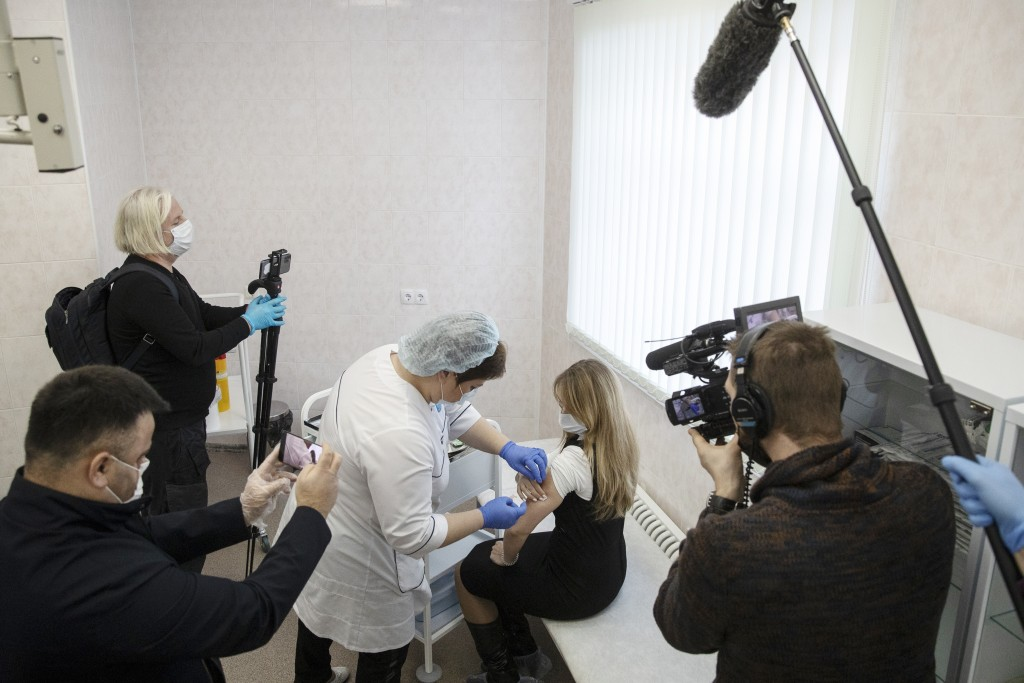 A Russian medical worker administers a shot of Russia's Sputnik V coronavirus vaccine in Moscow on Thursday, Dec. 10, 2020. While excitement and enthu...
