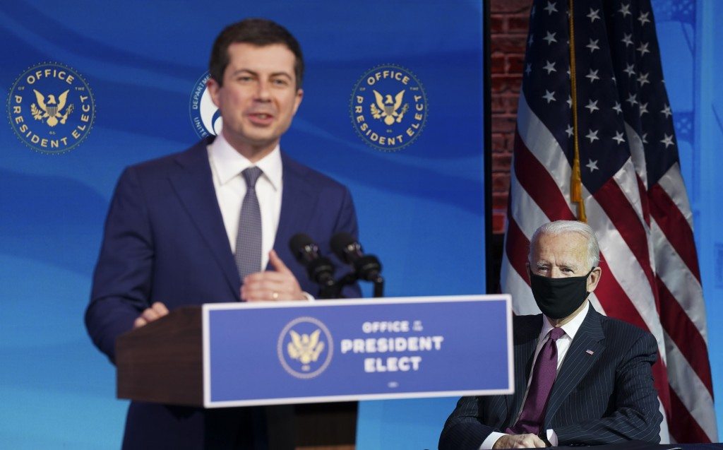 Former South Bend, Ind. Mayor Pete Buttigieg, President-elect Joe Biden's nominee to be transportation secretary, speaks as Biden looks on during a ne...