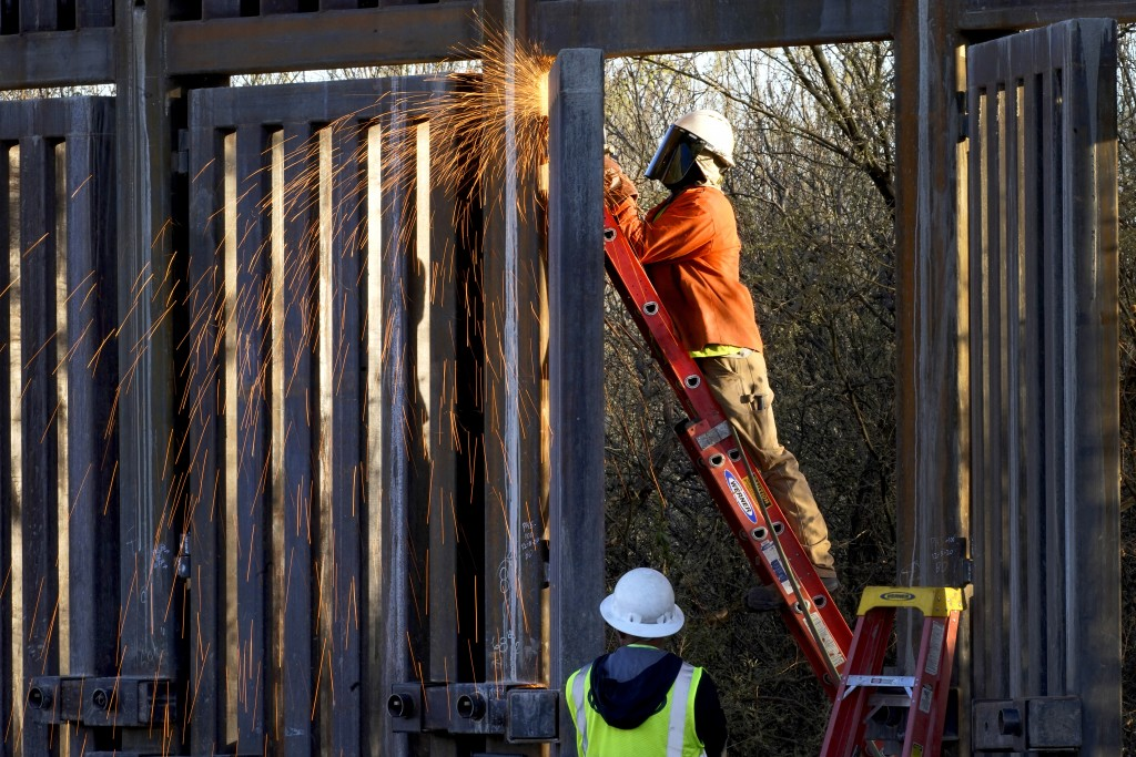 Crews construct a section of border wall in San Bernardino National Wildlife Refuge, Tuesday, Dec. 8, 2020, in Douglas, Ariz.  Construction of the bor...