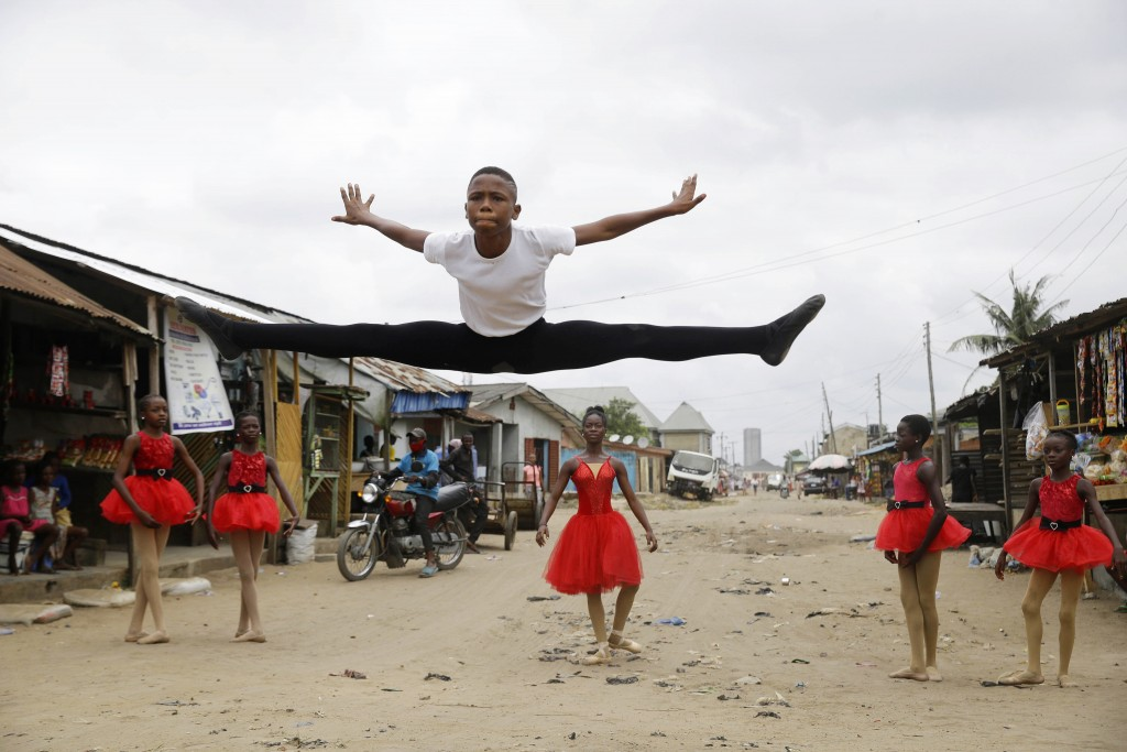 Ballet student Anthony Mmesoma Madu, center, dances in the street as fellow dancers look on in Lagos, Nigeria on Aug. 18, 2020. Cellphone video showin...