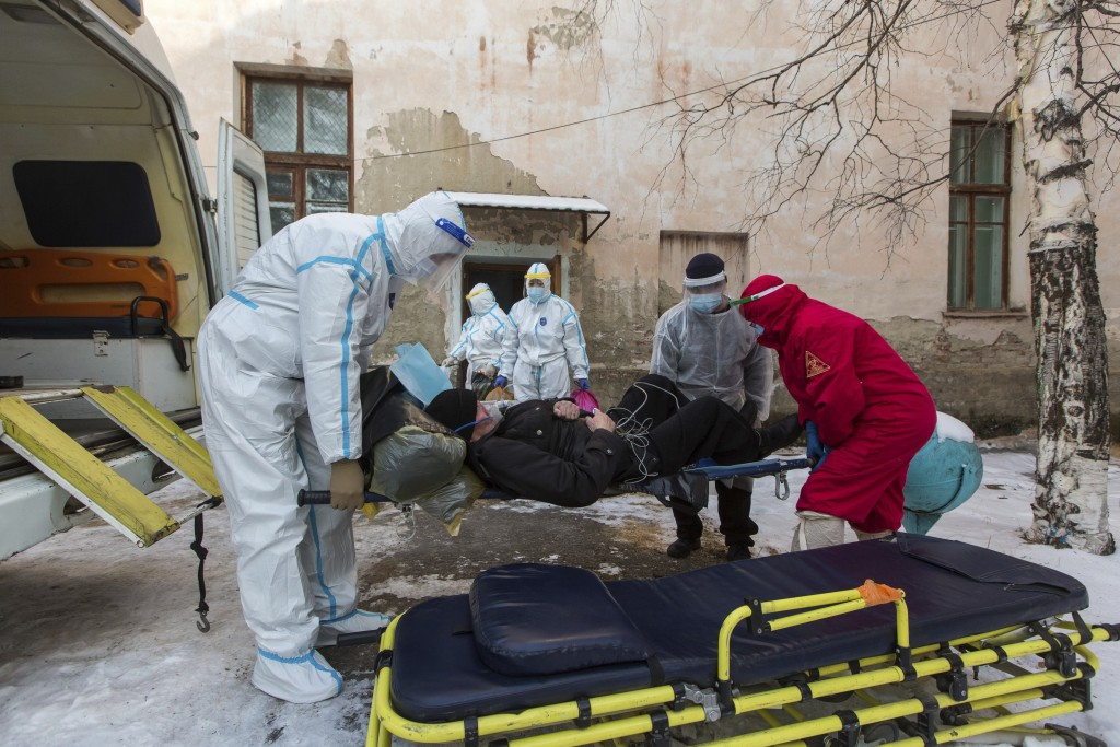 Medical workers transport a patient suspected of having coronavirus at a hospital in Zakamensk, Russia, in the  Buryatia region on Friday, Dec. 11, 20...